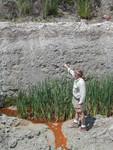 Tom Scott points at pit wall, Langston Quarry, 2002